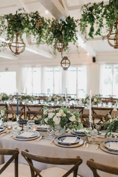Sophisticated dusty blue, matte green, and ivory wedding table decor | Image by Luke and Mallory