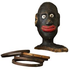 Early Carved Wood American Folk Art Carnival Ring Toss Head & Rings | From a unique collection of antique and modern carnival art at http://www.1stdibs.com/furniture/folk-art/carnival-art/