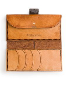 Beautifully practical. Designed to be your everyday purse… the coin/money section can fit notes laid flat, and there is a hidden pocket behind the