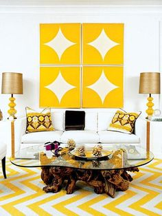 ModernChicHome: Pieces Inc - Gorgeous yellow and white living room with chevron patterned area rug.