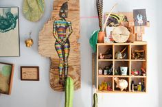 """The small illustration at left reads: """"Don't plan on it but if you're going to fail, fail HARD!"""" The knick-knacks in the wooden box are gifts from Eduardo's friends or items he's collected from his travels."""