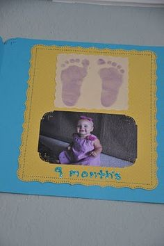Footprint and pictures for each month used as 1st Birthday party decoration and then I put them all into a scrapbook for safe keeping.  I scanned the originals first, so I can do something with the footprints later if I want too.