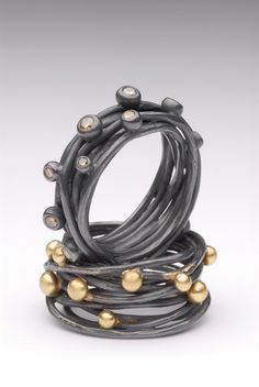 Oxidized silver and gold spaghetti rings. Handmade by Malcolm Morris