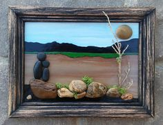 Beautiful scenery with a pebble couple or Parent and Child in the outdoors overlooking a green valley. Set in an open 5x7 rustic frame which is