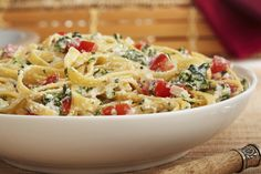 This easy, creamy pasta sauce of ricotta cheese, Parmesan cheese, milk, spinach, tomatoes and garlic is a tasty change of pace from classic tomato sauce.