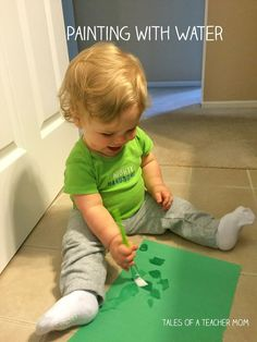 Painting with Water, one year old activity from Tales of a Teacher Mom