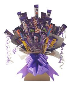 Cadbury's make fantastic chocolate and now it is available as a spectacular bouquet. Our Cadbury's Bouquet is stuffed with a massive range of 26 full sized Cadbury's chocolate bars – it makes the ultimate gift for any occasion. with Free UK Delivery. Chocolate Tree, Cadbury Chocolate, Chocolate Gifts, Chocolate Christmas Gifts, Chocolate Bars, Chocolate Chips, Diy Bouquet, Candy Bouquet, Bonbon