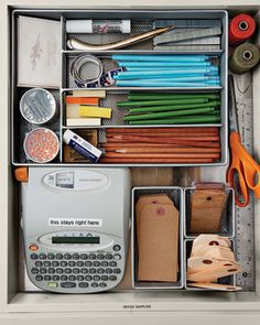 Office Supplies Drawer - They're not for cooking, but don't you always need a pen, scissors, a ruler, or a stamp when you're in the kitchen? Among Martha's drawer essentials are a label maker and tags and twine for gifts. Silvermesh drawer organizers, containerstore.com.