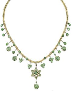 ANTIQUE DEMANTOID GARNET NECKLACE.  The necklace designed as a gold mesh chain, suspending a fringe of demantoid garnet collets, clusters and flower, mounted in gold, circa 1880.