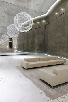 Wall_2 by Piero Lissoni for Living Divani and I belive Ball by Tom Dixon for Swarovski. FANTASTIC image!