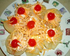 Blast from my Past:  Pear Salad halved pears, mayo, cheddar cheese, and a maraschino cherry. I only ever saw these in elementary school.