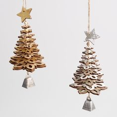 Our pair of handcrafted snowflake tree ornaments are composed of cascading layers of laser cut wood in alternating colors in gold and natural and silver and white. The rustic set of two includes gold and silver - each with a delicate bell.