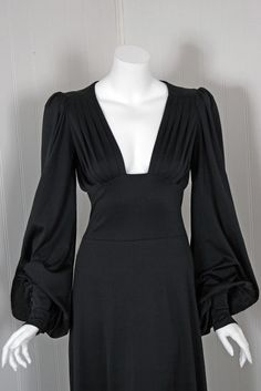 1970's Biba Seductive Low-Cut Plunge Black Billow-Sleeves Gown   From a collection of rare vintage day dresses at https://www.1stdibs.com/fashion/clothing/day-dresses/