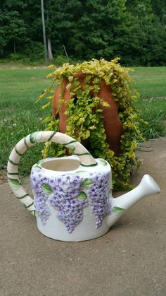 A personal favorite from my Etsy shop https://www.etsy.com/listing/400522977/vintage-ceramic-floral-watering-can