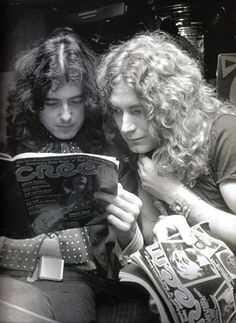 Jimmy Page and Robert Plant check out the press