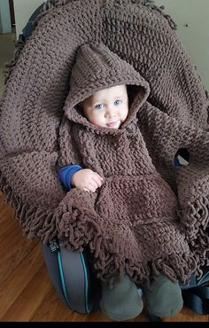 Crochet Poncho Ravelry: Hooded Carseat Poncho pattern by Alicia Cromwell - Another fast adorable project to add to the list! Cozy and functional. Crochet Baby Poncho, Crochet Car, Crochet Poncho Patterns, Crochet Amigurumi Free Patterns, Crochet Baby Clothes, Crochet For Kids, Irish Crochet, Crochet Gifts, Crochet Ideas