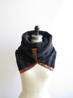 This chunky,practical and easy to wear scarf, that will give an instant new look to any of your coat . Not only It will become your best friend for the cold season , it will also be a timeless piece to your wardrobe. This scarf is made of 100% navy plaid soft wool. This fabric is very warm