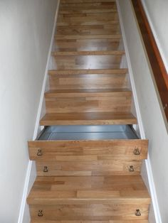 I like this, especially since I'm the queen of taking off my shoes at the bottom of the stairs and leaving them there. Now I'd have a storage space!