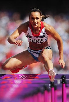 Jessica Ennis of Great Britain competes in the Women's Heptathlon 100m Hurdles Heat 1 on Day 7 of the London 2012 Olympic Games