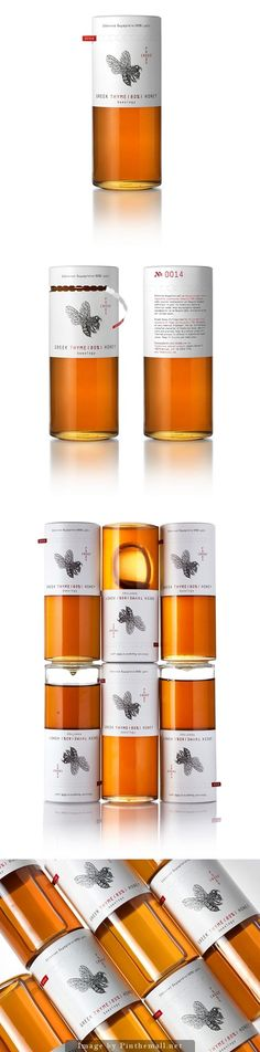 Honey packaging with tear away label revealing traditional looking twist off cap. Love the columnar design of the glass bottle.: