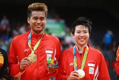 Gold medalists, Tontowi Ahmad and Liliyana Natsir of Indonesia celebrate after the Mixed Doubles Gold Medal Match on Day 12 of the Rio 2016 Olympic Games at Riocentro - Pavilion 4 on August 17, 2016 in Rio de Janeiro, Brazil.