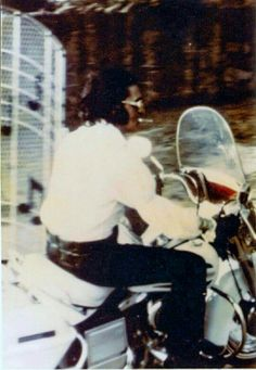 Elvis going through the music gates at Graceland on his 1971 Harley-Davidson FLH Electra-Glide - (said to be on ) July 4, 1972