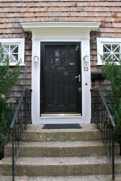 black front door with white storm door | AFTER: The front door, with its storm door in place. The old one was ...