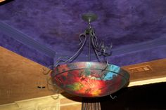 Venetian Plaster purple ceiling accenting hand painted glass fixture bowl.