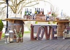 Don't forget about the little touches, add our rustic LOVE letters and our hurricane lanterns to your bar area to create a focal point.