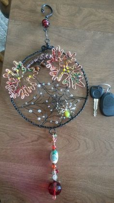 Wire wrapped beaded sun catcher with spider web.