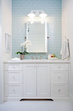 Charming White And Blue Bathroom Boasting White Hex Floor Tiles Features A  White Framed Eiffel Tower Print And A Polished Nickel Towel Holder Accent  White ...