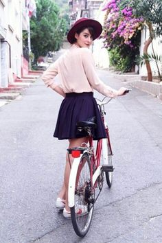 I don't know how to ride a bike but wearing skater skirt while doing it could be awesome.