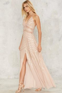 This bronze sequin gown is the perfect dress to rock at your BFFs wedding.