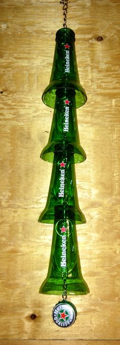 Awesome Etsy listing at https://www.etsy.com/listing/160649658/heineken-beer-bottle-windchime-recycled