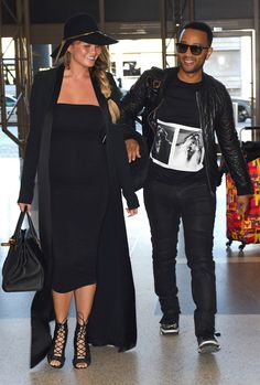 Chrissy Teigen & John Legend from The Big Picture: Today's Hot Pics  The soon-to-be parents arrive at LAX on Christmas.