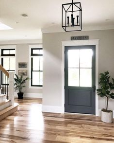 I kind of like the dark windows & door with light trim