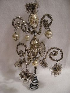 Unique vintage tinsel and glass Christmas Tree Topper.  Would be fun to make something like this.