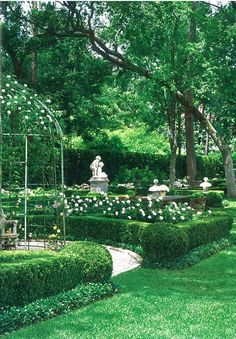 "boxwood and pale pink roses in a garden in Houston, Texas: Woodham, Tom, ""European Influence"", Veranda, August 2009.  Photography by Peter Vitale; Landscape design by Danny McNair"