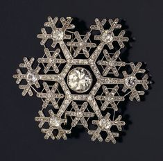 Image: Artist presented by Christies - A Diamond And Platinum-Mounted Snowflake Brooch By Faberge, Circa 1908-1913