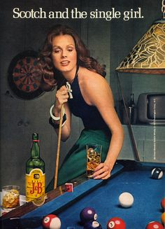 Now that's a WOMAN! ....and that's a pool table...there's a light....Oh, and there's a terrible scotch!