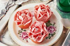 With jam centres and strawberry topping tinted butter cream, these cupcakes are pretty in pink and pretty for Mother's Day!