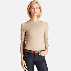 This sweater made with 19.5 micron, extra-fine Merino wool features the fine, smooth texture and elegant luster that only these fibers can provide. Designed with a basic crew neck and stylishly long ribbing at waist and cuffs, it looks great paired with wide-legged bottoms. The Merino wool is specially treated to prevent pilling and to make it machine washable.
