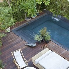 beautiful rectangle pool and wood deck Banquettes, Outdoor Spaces, Outdoor Living, Outdoor Decor, Marie Claire, Pergola, Rectangle Pool, Pool Colors, Parasol