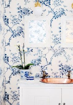 Love this antique blue statement wall.