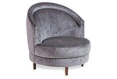 This modern swivel chair is crafted of walnut wood with a high, rounded back and plush seat cushion.