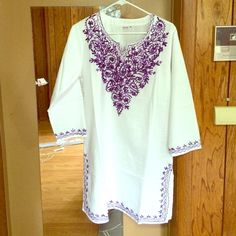 """Authentic Indian embroidered tunic Beautifully Hand embroidered from India. Purple embroidery.   Brand new, never worn. No tags. I'm 5'8 and it hits me mid thigh. Slots in the sides (tunic style) Chest is 20"""" across. Medium. The man I bought from said item has already been pre washed so it should not Shrink when washing or drying. Tops Tunics"""