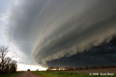 shelf cloud: a low, horizontal, wedge-shaped arcus cloud. A shelf cloud is attached to the base of the parent cloud, which is usually a thunderstorm, but could form on any type of convective clouds. Rising cloud motion often can be seen in the leading (outer) part of the shelf cloud, while the underside often appears turbulent and wind-torn. Cool, sinking air from a storm cloud's downdraft spreads out across the land surface, with the leading edge called a gust front.