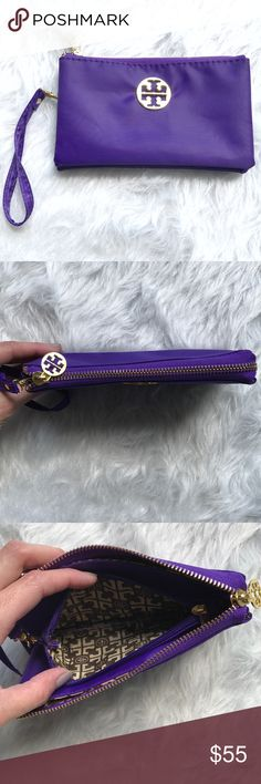 TORY BURCH wristlet Purple fabric Tory burch wristlet. 3 pockets total with zip closures. Excellent condition. Tory Burch Bags Clutches & Wristlets