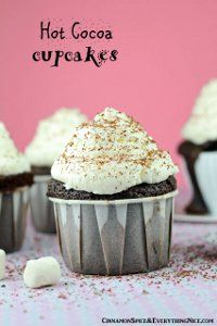 """Every once in a while there comes a cupcake flavor that makes you say, 'That's probably the best cupcake recipe on the planet!"""" Well, this is one of them. A stop-dead-in-your-tracks and make this now kind of recipe. There is nothing that says warm winter dessert like these Hot Cocoa Cupcakes and we're sure you'll agree. Snuggle up with some of these and we're sure you won't be disappointed."""