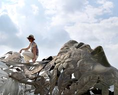 Irish artist Linda Brunker created this monumental sculpture as a reminder of our connection to nature and the environment. Sculpture Projects, Public Art, Artist At Work, Irish, Connection, Lion Sculpture, Environment, Statue, Park